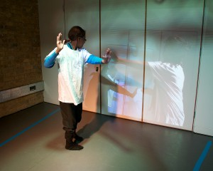 young person experimenting with a telepresence screen
